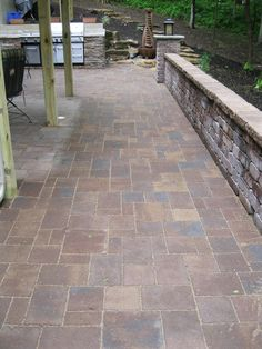 Paver patio with seating wall and built-in outdoor kitchen. #patio #patiolife #outdoorliving #hinklehardscapes #pavers