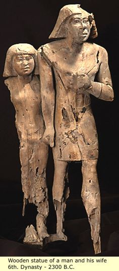 Despite its extensive damage, this statue of a couple walking is one of the masterpieces of wooden statuary from the Old Kingdom. The two figures are standing side by side, the woman to the right of the man. She is much smaller, and, according to the conventions of Egyptian art, is slightly behind her partner; her left arm is wrapped tenderly around her husband's waist.  6th Dynasty - 2300 B.C.