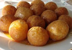 Loukoumades - Greek Honey Puffs - we get these at the International Street Fair near us, that is held every Labor Day weekend, and they are delicious. But who wants to wait a whole year for a treat you love? Greek Sweets, Greek Desserts, Greek Food Recipes, Indian Desserts, Sweet Recipes, Greek Donuts, Mini Doughnuts, Honey Puffs, Greek Cooking