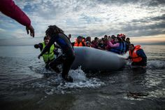 Wednesday, Februaru 24: Mytilene Refugees and migrants are helped by volunteers on their arrival aboard a dinghy at Mytilene on the northeastern Greek island of Lesbos, Tuesday, Feb. 23, 2016. Nearly 100,000 migrants and refugees have traveled to Greek islands from nearby Turkey so far this year.  -     © Manu Brabo/AP
