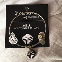 Shell Alex and Ani Silver shell Alex and Ani. In great condition. Comes with card. Alex & Ani Jewelry Bracelets