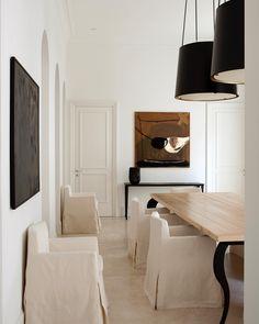 White, black, cream, light wood, bronze. Minimal but super elegant dining room.