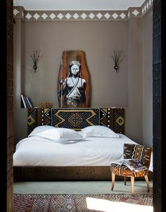 simple bedroom with well placed mudcloth and accessories