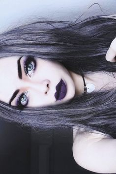 Those purple lips are amazing. And i love her grey hair. Nu goth makeup                                                                                                                                                                                 More