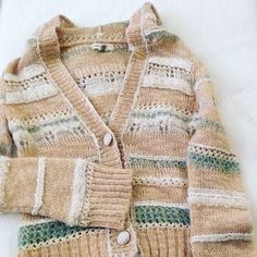 Anthropologie hooded sweater Sleeping on snow brand with crocheted buttons and pastel shades of tan and green size small in perfect condition Anthropologie Sweaters