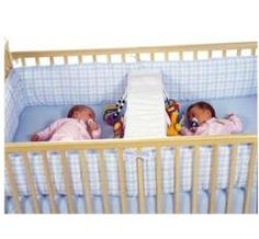 """Crib solutions for twins! One pinner says, """"We had one of these for our twins. we used it to divide the crib in half and both babies slept on one side and we had a spot to change daipers on the other side."""""""