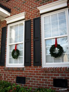 How to put a wreath on your home. I like the wreath on windows with red ribbon.