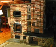 large masonry stoves - custome designs with builtin cookstoves, smokers etc. Super efficient wood burners.