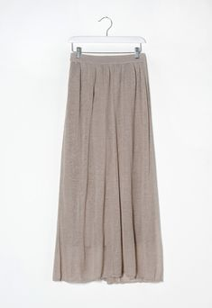 Long linen skirt Light, cool fabric, characterised by delicate ton-sur-ton motif. Regular gathered waist. The flowing line has a wide, comfortable fit. Ankle length.