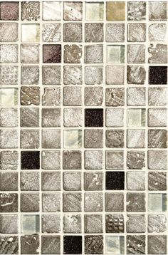 Mogao Glass & Stone Mosaic, featuring strong earthy tones in textured stone with random inserts of glass with an inner sparkle.