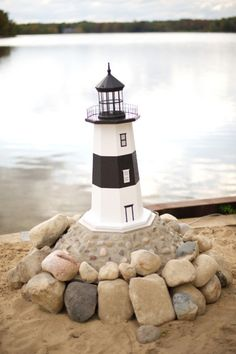 Kelly Sweet Photography captured this cute Michigan lighthouse decoration at a wedding in Northern Michigan