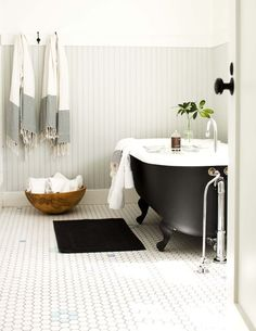 nice bathroom. great tile and light gray beadboard. Black clawfoot tub