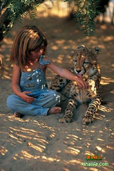 Africa | Just one of many fantastic pictures from Tippi's childhood | Tippi was born in Namibia, where her parents, Alain Degré and Sylvie Robert, worked as freelance wildlife photographers. She was named after Tippi Hedren. During her stay in Namibia, she befriended wild animals, including the leopard she nicknamed J