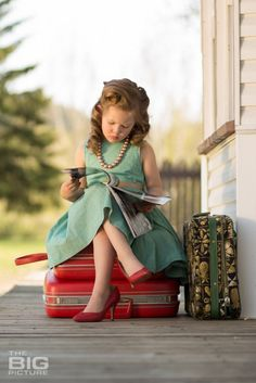 My niece Aria sitting on my boarding school 1957 Samsonite luggage. childrens-birthday-portraits-photography-theBIGpicture-badass-vintage-runaway-16