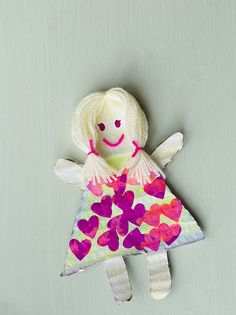 Cardboard Dolly DIY garland, cut some doll shapes out of cardboard then let your kids decorate them..