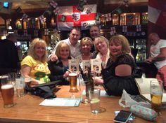 A celebratory drink with friends after the Bolton book launch