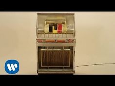I love how the video shows the record player grabbing the record! It's soo cool and creative. Well since I'm listening to it I decided to share it with my Hooligans! Bruno Mars Moonshine.