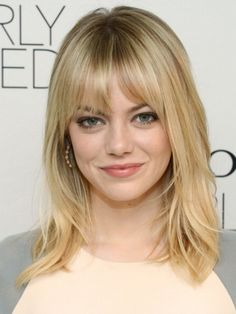 Emma Stone's look glows, thanks to her perfect Light Blonde Golden #hair #color. Get your own most flattering color to cover gray hair right at home here: http://www.haircolorforwomen.com/breakthrough-hair-color-system-your-salon-doesnt-want-you-to-know-about-p/