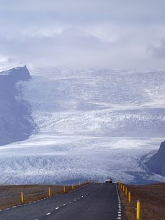 road disappearing into the ice of vatnajökull glacier, iceland