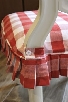 Red and white buffalo check slipcovers for dining chairs. Great for Christmas!