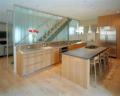 Dig these channel glass walls used to enclose stairs and let light through...