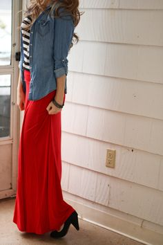 How to wear a long solid-color skirt: Chambray shirt, black and white striped top, red maxi skirt, black pumps, large loose curls