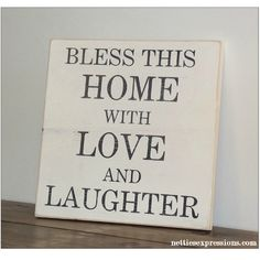 Bless this home with love and laughter  This handmade wooden sign would make the perfect house warming gift ...or add that extra cozy touch to your home with the beautiful wall hanging.$32.00