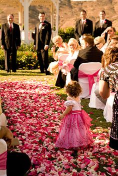 Rose petals make a big impact on wedding decorations. Bold and beautiful colors are in. The rose petals are stunning and it would be hard to picture this wedding venue without them!