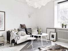 A monochrome one-bedroom apartment in Gothenburg| Styling by Charlotte Ryding | Photo by Jonas Berg for Swedish broker Stadshem| via Style and Create