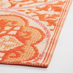 Featuring an ivory and orange floral medallion pattern designed exclusively for World Market, our reversible woven floor mat is soft underfoot, easy to care for and great for indoor and outdoor use.