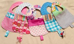 Baby patchwork bibs with pacifier loop, reversible (choose your favourite colour) on Etsy, $11.13