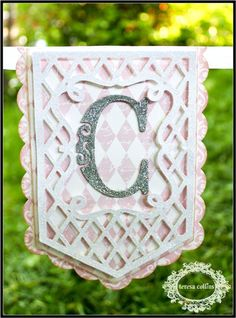 Personalize a banner for any special occasion. This banner was created by Sesil featured on the Teresa Collins blog, using the new Pretty Pennants cartridge! #cricut