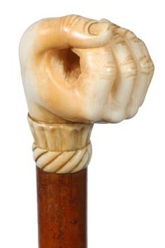 Reversed Ivory Fist Cane-19th Century-A carved ivor