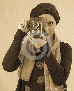 Young Woman Holding Old Camera In Hijab And Colorful Scarf - Download From Over 35 Million High Quality Stock Photos, Images, Vectors. Sign up for FREE #Arabic #woman #highfashion #makeup #hijab #colorful #scarf #fashion #earrings #Arabian #Oriental #galleries #Turkish #Islamic #Egyptian #Burnette #Veil #African #Turban #AfricanWrap #Wrap #Portrait #Girl #Young #Vintage #Camera #Necklace #Hamsa #Photography #StockPhotography #Art #portfolio #Background #FashionPhotography #Lipstick #Eyeliner