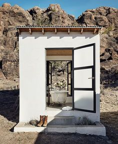 Behind her main house, Lambert built a row of outbuildings that combine a modernist aesthetic with local materials. This one is both for bathing and for admiring the rocky views.
