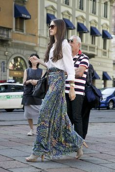 A long maxi skirt paired with heels always compliments long legs