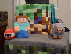 """Steve, TNT and Sheep.  All made with rice krispy and covered in MMF Fondant.   (Please excuse the powder sugar dust.  I have since bought a steamer to """"clean up"""" my cakes) :)"""
