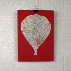 Mixed up Bristol: Hot Air Balloon Collage with Map on Red by thr3equartersdesign - blue / turquoise map of bristol areas cut in balloon shapes