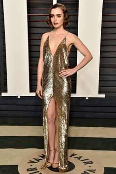 Lily Collins in Saint Laurent at the 2016 Vanity Fair Oscar Party on February 28, 2016