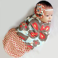 Swaddling Blanket Pattern - make one of these fast and easy with velcro tabs to keep it snug.   The model baby is SOOO pretty too! :)
