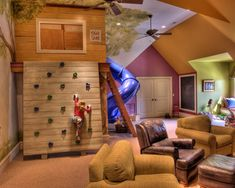 If I ever have a vaulted ceiling in a room over the garage ... how cool is this?!? Indoor treehouse and climbing wall! Just add a trampoline in the floor!