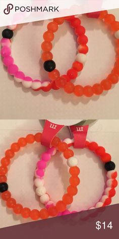 """Bundle of 2 Silicone Lokai Style Bracelets You will receive one red and one pink/red multicolored """"pink Camo"""" bracelet. Lokai Jewelry Bracelets"""