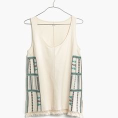 Madewell Embroidered Fringe Tank A toss-on tank top with rich panels of embroidery inspired by a vintage Peruvian scarf. Finished with a fringe of handmade tassels for that found-it-in-a-market feel.  Color: bleached linen with True to size, 100% cotton. Worn and washed once – no stains, tears, holes or pilling – in excellent condition! Bundle & save ! Sorry -  trades! Madewell Tops Tank Tops