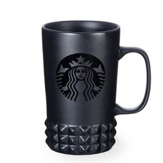 A ceramic coffee mug with a matte black body and studded details, part of the Starbucks Dot Collection.