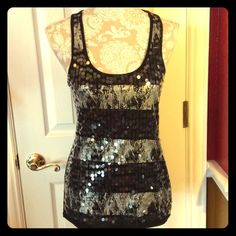 Black & silver tunic length tank top sequined Rue 21, size medium. 65% polyester 35% rayon. Black and silver racerback long tunic length tank top with paillette sequins. Rue 21 Tops Tank Tops