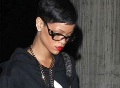 playing favorites rihannas been spotted all about town in pradas minimal baroque sunwear and shes got a new spin on her eyewear