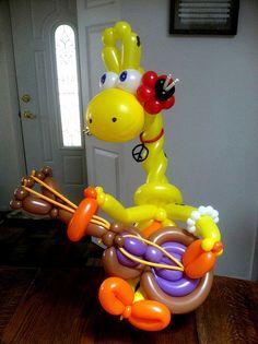 Giraffe Baez balloon sculpture by Smiling Bald Balloons, via Flickr