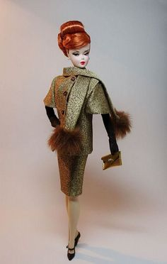 Vintage Barbie in Haute Couture - One of my MOST favorite outfits!!  The bodice of the dress and the lining of the jacket were teal blue.  The hat was wide-brimmed fur, which copied the fur on the ends of the scarf.  LOVED this outfit!