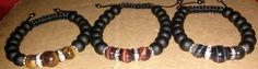 Tiger Eye and Black bead bracelets...Red, Golden, and Blue  Web: bijoubynija.com Facebook: Bijou By Nija