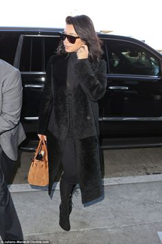 Jetsetter: Kim Kardashian was pictured arriving at LAX on Tuesday following a family vacation in Montana